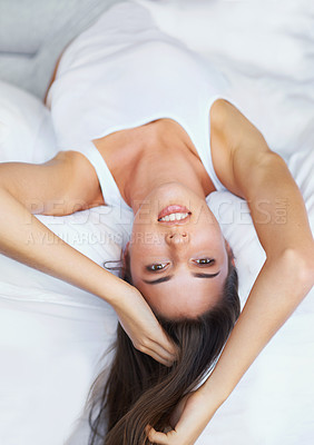 Buy stock photo Portrait of an attractive young woman lying on her bed