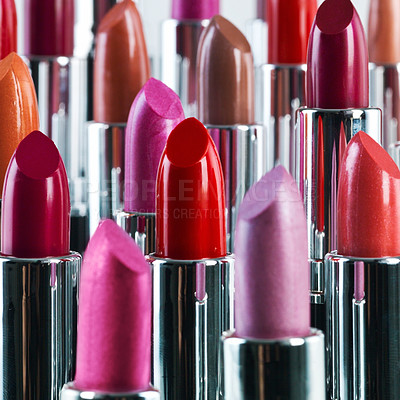 Buy stock photo A studio shot of different coloured lipsticks