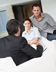 Happy young couple in discussion with a financial advisor
