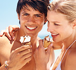 Closeup of a young couple enjoying an ice cream cone