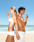 Image of a  couple having an ice cream at the beach