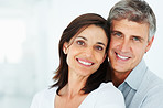 Closeup of a happy mature couple together over a background