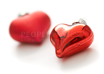 Buy stock photo Closeup of two heart-shaped christmas decorations on a white background