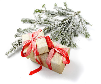 Buy stock photo Christams presents and a branch of a fir tree, isolated on white - copyspace