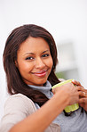 Closeup portrait of a cute African American woman with a cup