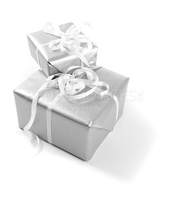 Buy stock photo Christmas presents wrapped in silver paper, isolated on white - copyspace