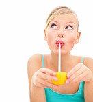 Young charming girl sipping orange juice with a straw over white background