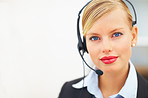 Portrait of happy receptionist with headphones