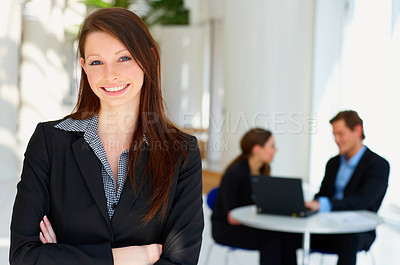 Buy stock photo Portrait of a young female in front of a workgroup