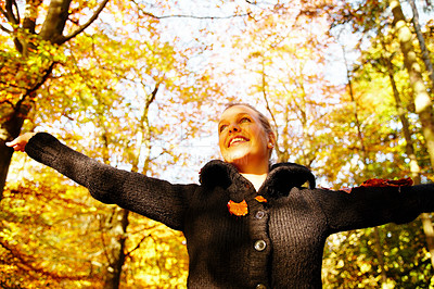 Buy stock photo Portrait of smiling young female spreading her arms out in the forest