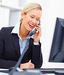 Young business woman talking on telephone in office