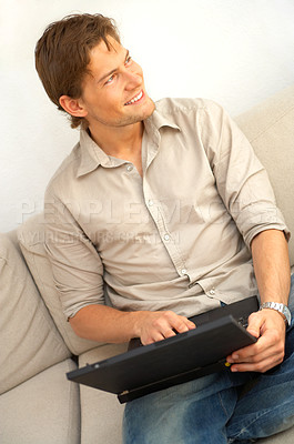 Buy stock photo Young man relaxing with laptop