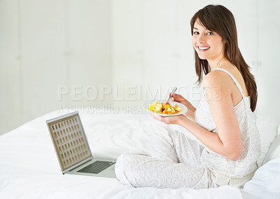 Buy stock photo Beautiful young lady eating fruit salad