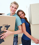 Happy couple carrying boxes moving house