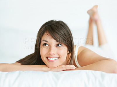 Buy stock photo An attractive young lady looking at copyspace