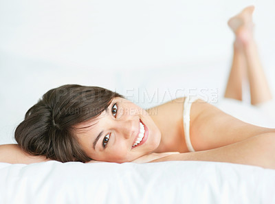 Buy stock photo Pretty young female relaxing on the bed