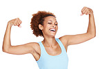 Smiling young lady flexing her biceps on isolated white