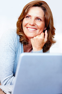 Buy stock photo Smiling young female using laptop - Copyspace