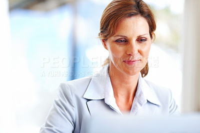 Buy stock photo Young business woman working on laptop at office