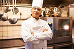 Smiling male chef in commercial kitchen