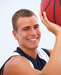 Man smiling and holding a basketball isolated on white
