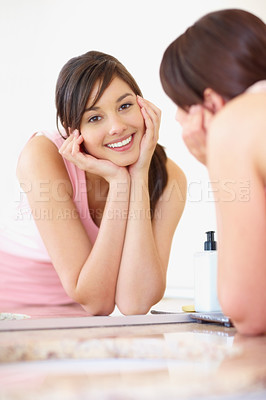 Buy stock photo Lovely young female looking at herself through the