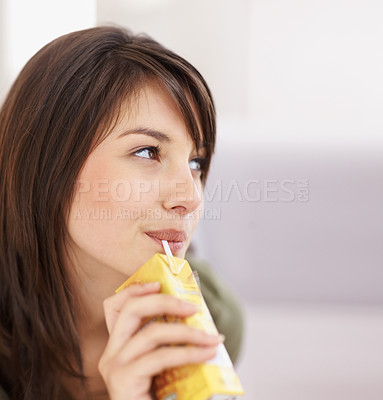 Buy stock photo Cute young female sipping juice
