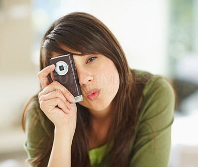 Buy stock photo Cute female taking a picture with a cellphone