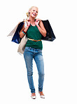 Full length of a happy young lady standing with shopping bags