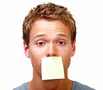 Young man balancing white blank card on mouth