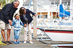 Happy grandparents with their granddaughter at dock