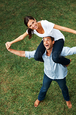 Buy stock photo Pretty woman on top of mans shoulders