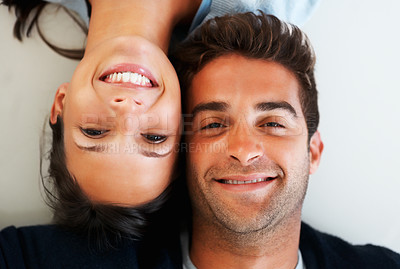 Buy stock photo Affectionate couple lying on the floor