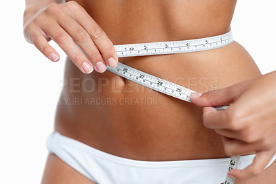 Buy stock photo Woman measuring her waistline