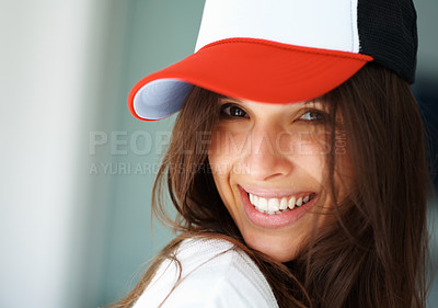 Buy stock photo Pretty woman with baseball cap smiling