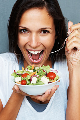 Buy stock photo Woman holding bowl of salad looking at camera