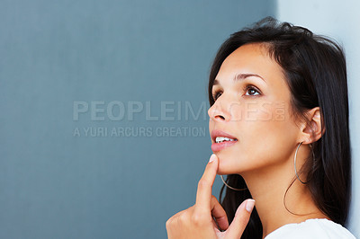 Buy stock photo Pretty woman smiling daydreaming against blue background