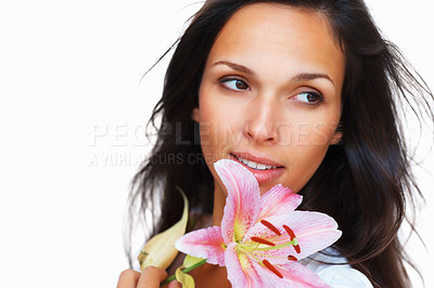 Buy stock photo Head shot of pretty woman looking outward while holding a flower