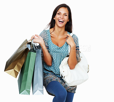 Buy stock photo Enthusiastic woman holding shopping bags against a white background