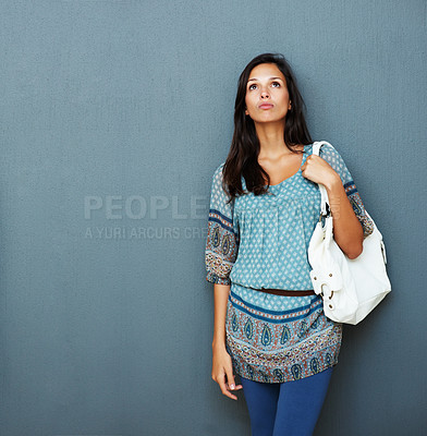 Buy stock photo Standoffish woman looking up against blue background