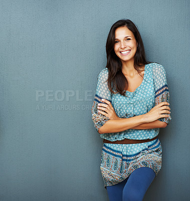 Buy stock photo Confident woman with her arms crossed against a blue background