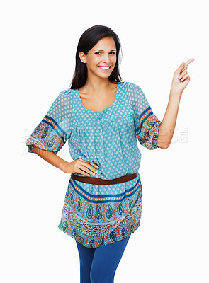 Buy stock photo Smiling woman pointing with hand on hip against a white background