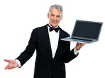 Well dressed man displaying laptop on white background