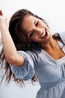 Buy stock photo Portrait of a crazy young woman dancing against white background