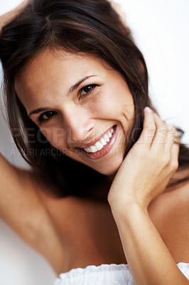 Buy stock photo Closeup portrait of a beautiful young woman posing against white background
