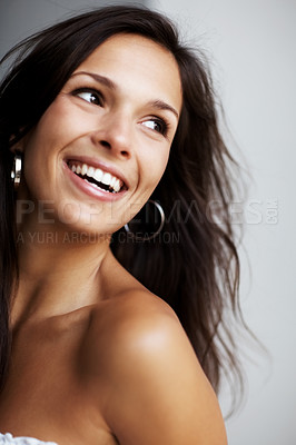 Buy stock photo Closeup portrait of a beautiful young woman as she looks back happily - copyspace