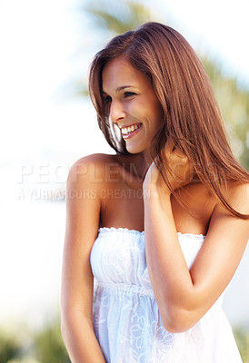 Buy stock photo Portrait of a smiling young female model posing in a park - Outdoor