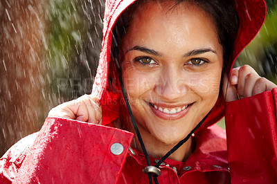 Buy stock photo Closeup portrait of a cute teenage girl holding a raincoat hat on head - Enjoying in rain