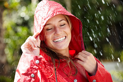 Buy stock photo Portrait of smiling teenage girl enjoying the rain wearing a red raincoat - Outdoor