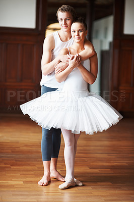Buy stock photo Full length of a smart teenage boy hugging his dance partner from behind